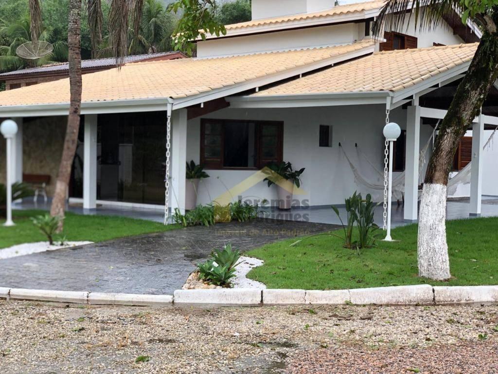 Casa com 5 dormitórios à venda, 400 m² por R$ 1.400.000 - Co