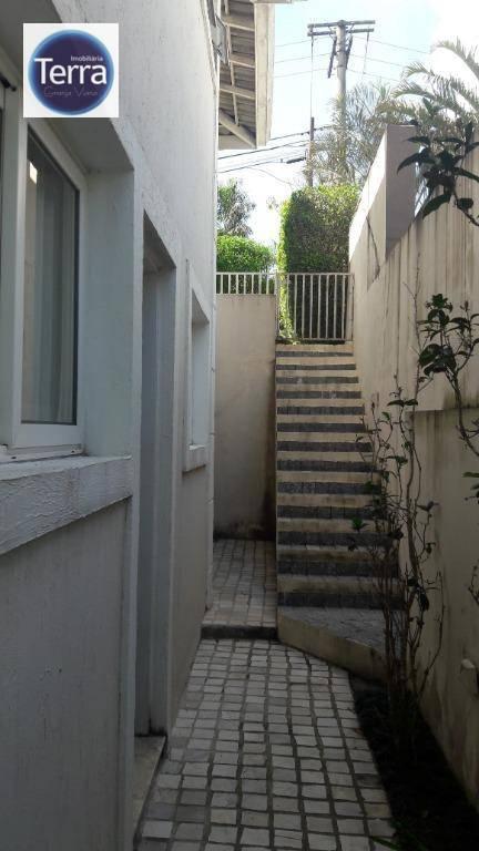 Casa com 4 dormitórios para alugar, 320 m² por R$ 5.120/mês - Golf Village - Granja Viana