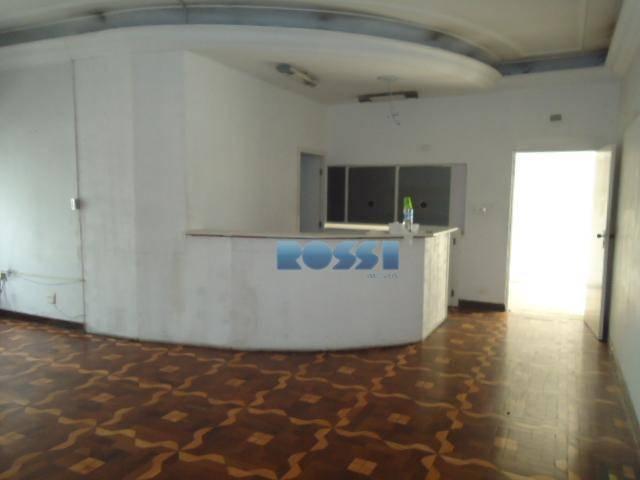 casa comercial - possui 15 salas, 03 salões, 09 wc, cozinha, refeitório, e 04 vagas.possui poço...