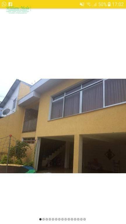 Sobrado com 3 dormitórios à venda, 295 m² por R$ 750.000 - J