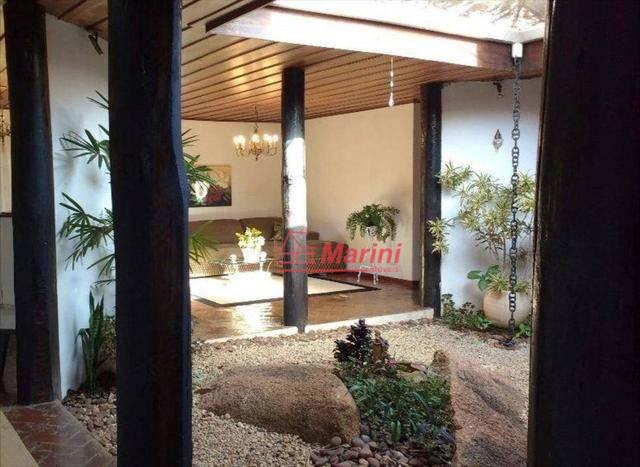 casa incrível em condomínio de luxoárea externa com churrasqueira ampla e piscinajardim enorme2 salas em 2...