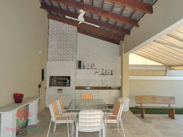 sobrado à venda no jardim acapulco em guarujá, sala 3 ambientes com lavabo, 5 suítes, cozinha...