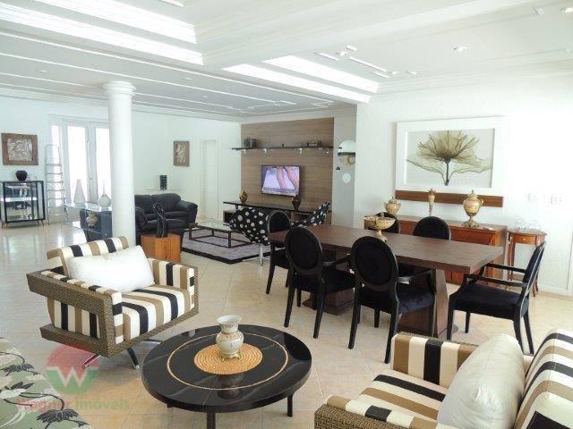 sobrado à venda no jardim acapulco em guarujá, sala 4 ambientes com lavabo, 4 suítes sendo...