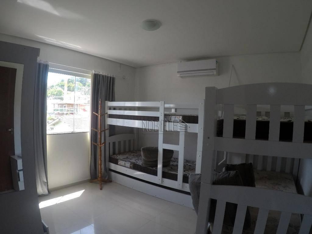 Apartamento com 2 dormitórios para alugar, 60 m² por R$ 1.670,00/ano - Ponta das Canas - Florianópolis/SC