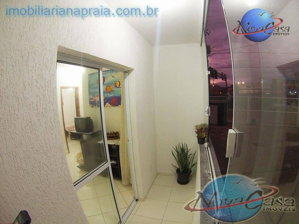 Apartamento 2 dormitórios com Sacada e Garagem a 150 mts da Praia
