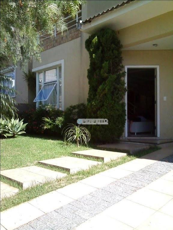 Casa com 4 dormitórios à venda, 238 m² por R$ 850.000 - Condomínio Vale do Arvoredo - Londrina/PR