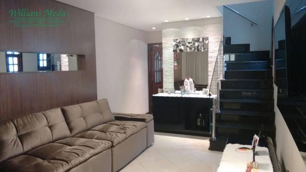 Sobrado com 3 dormitórios à venda, 132 m² por R$ 650.000 - J