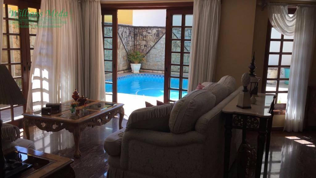 Sobrado residencial à venda, 3 dormitórios, 5 vagas. Vila Rosália, Guarulhos.