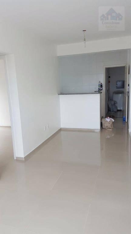 Apartamento com 2 dormitórios para alugar, 60 m² por R$ 900/mês - Parque das Bandeiras - São Vicente/SP