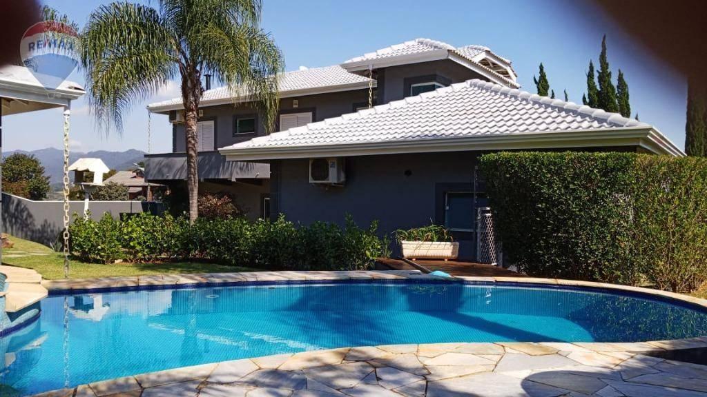 Casa com 4 dormitórios à venda, 380 m² por R$ 2.200.000 - Condominio Porto Atibaia - Atibaia/SP