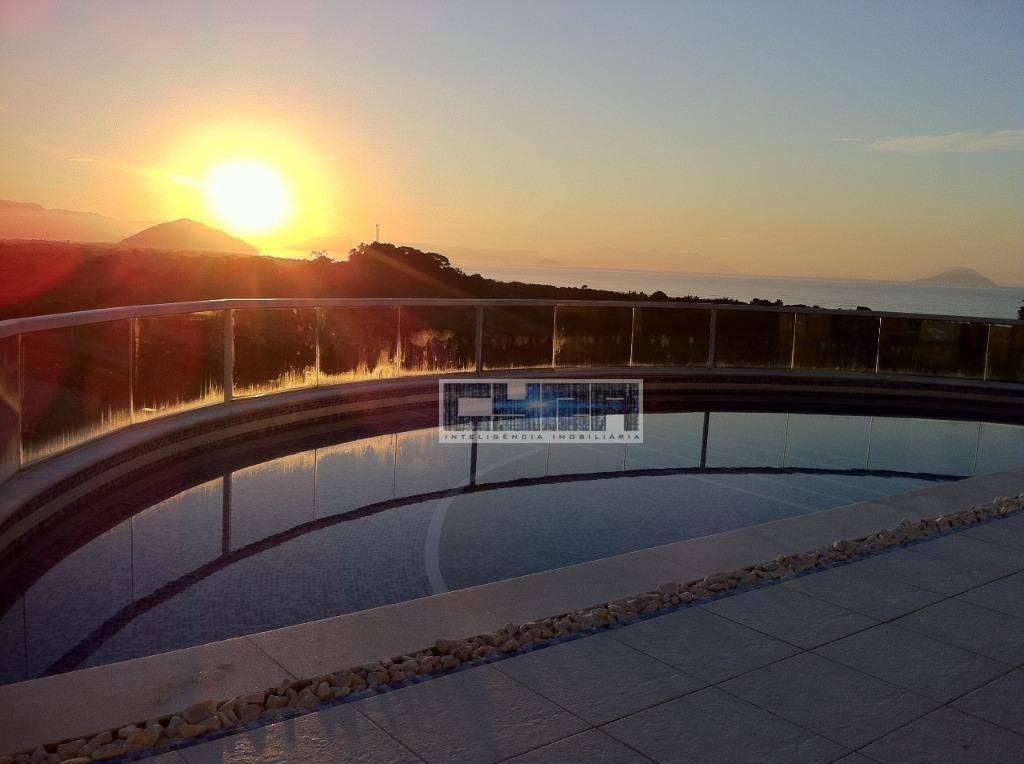 Casa 4 suites, 8 vagas e vista para o mar de Bertioga