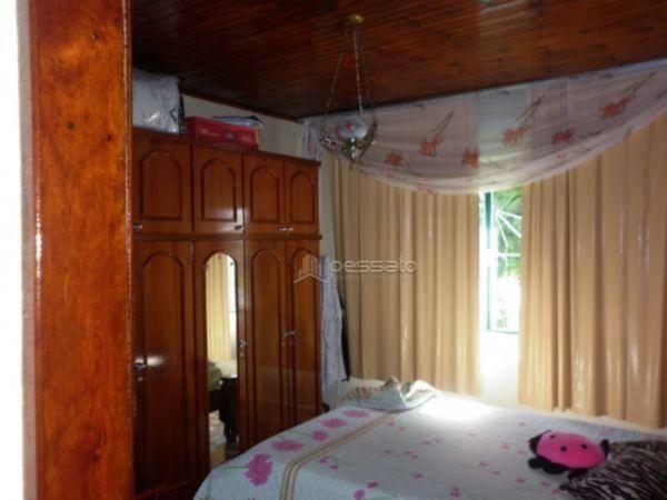 casa 4 dormitórios em Gravataí, no bairro Santa Fé